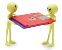 Two little fellas holding some floppy discs